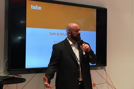 Speaker presenting Tufin and DFLabs joint offering